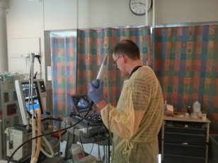 Dr. Phil Jones, CCW faculty, performing a point of care TEE for a patient in shock.