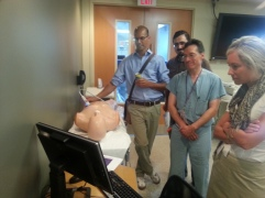 Faculty trying out the simulator