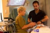 Kate Hayman demonstrates internal jugular vein and carotid artery on standardized patient