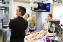 Team 5 attempting to determine the cause for their patient's respiratory distress