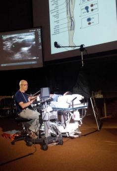 Dr. Mayo demonstrating DVT scanning.