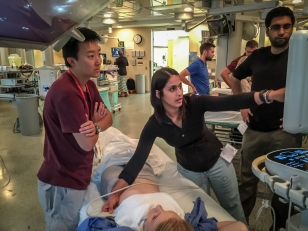 Alex Dong at the bedside